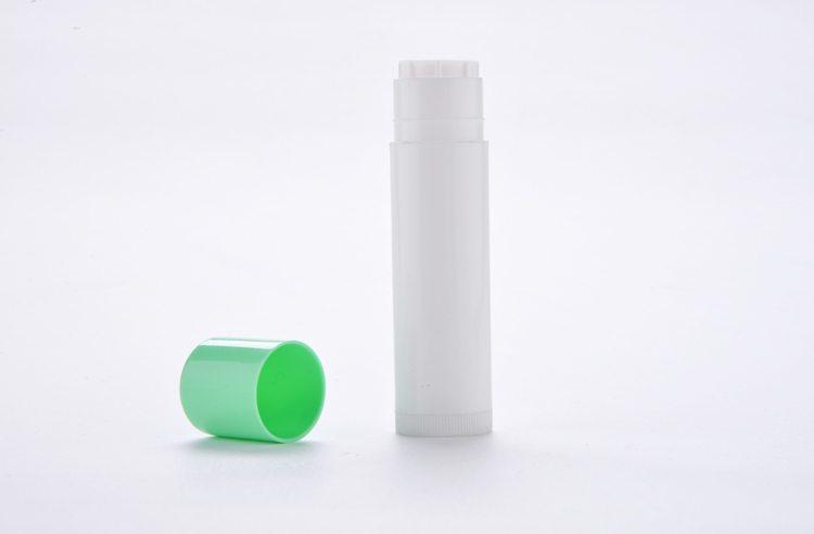 white plastic lip balm tube